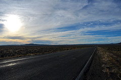 Taos - The Sun Is Setting (Drriss & Marrionn) Tags: road travel sunset sky panorama usa cloud newmexico car clouds landscape highway outdoor roadtrip wideview