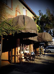 The French Hotel (Melinda * Young) Tags: california urban sun holiday brick awning hotel berkeley october chairs sidewalk tables northside shattuckave