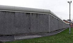 Prison Wall. (ManOfYorkshire) Tags: lighting camera building male wall concrete path run system prison crime tall perimiter rounded plinth legal doncaster restraint prisoners resettlement lockedup offence 1145 categoryb serco
