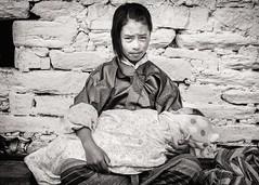 The Babysitter (Trent's Pics) Tags: baby girl festival infant child bhutan lifestyle kira babysitter tsechu bumthang domkhar