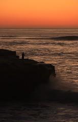 The Fisherman (yolanda.koutraki) Tags: ocean california sunset usa rock la fishing fisherman san waves diego jolla