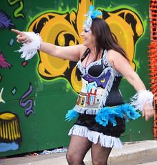 La Dame de Oak Street connects with a friend in the crowd (Monceau) Tags: walking women colorful neworleans parade mardigras beadwork streetnames kreweoftucks damesdeperlage