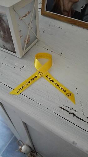 10mm geel lint met zwart bedrukt