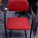 Red fabric stacking chair