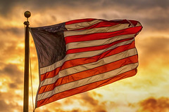 American Sunset On Fire (Striking Photography by Bo Insogna) Tags: sunset summer sky usa cloud sun sunlight color america sunrise freedom democracy symbol stripes flag united country dramatic patriotic national american government states rippled independence patriotism symbolic jamesinsogna