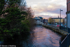 Evening in Ennis (stevenkeating58) Tags: street city ireland sunset wet water skyline clouds reflections river spring rooftops bubbles ennis waterways countyclare riverfergus
