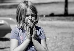Having Fun (Kerstin Winters Photography) Tags: portrait people bw white black color girl monochrome nikon child faces lifestyle bubbles onecolor nikkor hintofcolor d5500