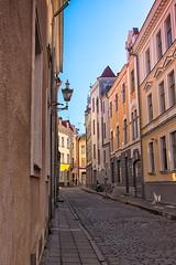 Narrow Street In Tallinn (k009034) Tags: street door old city travel windows sky people wall buildings town europe tallinn estonia cityscape pavement no nopeople paving lantern curve destinations traveldestinations 500px teamcanon