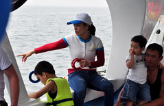A spot of fishing (Roving I) Tags: sea tourism boys children boats fishing tourists vietnam crew pointing lifejackets danang reels seahorseyacht phanannhi