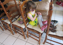 Her chair train has lots of shoes, water and books (Monceau) Tags: playing corinne shoes chairs waterbottles chairtrain