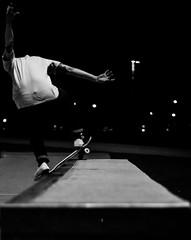 In motion (gloharnchoi) Tags: park blackandwhite bw chicago motion nature field night contrast dark illinois movement noir ride angle natural skateboarding bright bokeh skating chitown move hobby riding nighttime flux skatepark skateboard skater nightlife hobbies angular grind depth noire gind chicagoan