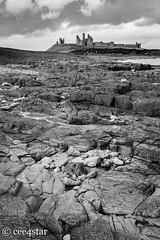 Shoreline leading to Dunstanburgh Castle (cee4star) Tags: uk longexposure sea england blackandwhite castle water canon landscape mono coast rocks waves outdoor northumberland filters northeast dunstanburgh formatt leefilters canon7d littlestopper 1635lf4