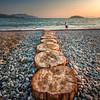 Tom (roseysnapper) Tags: boy sunset sea summer seascape beach turkey pebbles innocence sigma1020mm calisbeach canoneos40d
