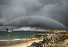 Corbletts Rainbow, Alderney (neilalderney123) Tags: storm eye beach water weather clouds landscape rainbow olympus alderney corbletts 2016neilhoward