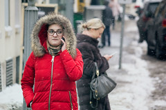 Standing Out (Ktoine) Tags: street red girl glasses phone russia moscow candid cellular hood talking