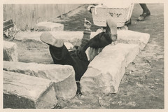 Man falling off a stone seat (simpleinsomnia) Tags: old white man black monochrome vintage found blackwhite antique snapshot over falling photograph fallen vernacular humpty dumpty foundphotograph fallenover humptydumpty