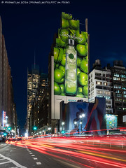 An Apple A Day ... (DSC00550-Edit Recrop) (Michael.Lee.Pics.NYC) Tags: newyork night twilight sony 34thstreet advertisement bluehour pennstation 8thavenue lighttrail ciroc traffictrail applevodka fe1635mmf4 a7rm2