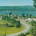 NW Beulah Honor MI 1950s Coming into town from Honor WORKING TRAPP FAMILY FARM DAYS on left near Village Homes Stores Businesses on Crystal Lake just off US-31 View Looking Southwest toward Frankfort3