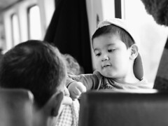 High five, Daddy? (d_t_vos) Tags: windows boy people blackandwhite bw window monochrome hat train hair asian child hand zwartwit ns candid seat fingers compartment cap seats fist ear sw highfive littleboy coup backofthehead dickvos dtvos