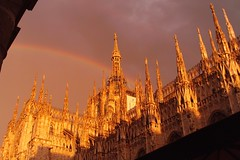 Rainbow over the Milan Cathedral (stranger_bg) Tags: santa city travel light sky italy cloud building tower art church colors saint skyline architecture grande photo rainbow san europe arch view christ cathedral photos outdoor maria basilica milano mary ngc picture stranger romano explore cielo views di christianity monuments metropolitana nativity metropolitan cattedrale nascente cathedralbasilica   caterals strangerbg