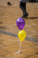 Runaway Balloons with Hat (Philip Gillespie) Tags: street city uk wild abstract abandoned feet wet water hat rain yellow contrast canon balloons lost shower scotland flying edinburgh purple legs wind pavement candid free floating gale paving april string ribbon princes breeze lothian gust roaming 2016
