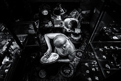 The Watchmaker (Axel Halbgebauer) Tags: street travel portrait blackandwhite bw man men clock shop night triangles composition zeiss work dark lowlight asia candid sony watch working vietnam workshop worker fe hanoi watchmaker
