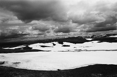 Fields of Snow and Sky (IggyRox) Tags: light sky blackandwhite snow mountains film nature beauty norway clouds 35mm norge europe view north dovre hike massive scandinavia vast dovrefjell oppland snoheim