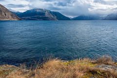 Lake by mountains (imagesbystefan.com) Tags: ocean travel sea vacation sky cliff mountain lake alps nature water beautiful norway clouds season landscape outdoors bay seaside spring scenery europe day view natural cloudy background scene fresh hills clear explore valley summit environment fjord daytime serene nordic peaks scandinavia range idyllic slope