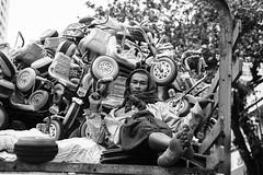 Man with children's merchandise (David Gabriel Moreno) Tags: monochrome children toy tricycle wheels transportation myanmar product mandalay