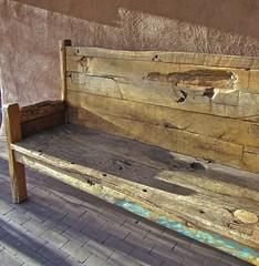 a little aged.... (mar-itz) Tags: wood light sun newmexico santafe color art bench downtown adobe age distressed lafonda