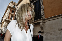 Windswept and interesting! (Baz 120) Tags: life street city portrait people italy rome colour roma girl contrast europe italia faces candid strangers streetphotography streetportrait olympus streetphoto manual unposed streetfaces omd decisivemoment candidportrait candidphotography m43 streetcandid mft streetphotograph primelens em5 romestreets romepeople candidstreet zonefocusing candidface flashstreetphotography 75mmfisheye romecandid grittystreetphotography