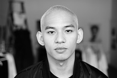Adam-Lin, fashion designer (Eric Flexyourhead (shoulder injury, slow)) Tags: portrait bw canada monochrome fashion vancouver zeiss person blackwhite chinatown gallery bc bokeh designer britishcolumbia exhibit exhibition collection popup stylish shallowdepthoffield fashionable columbiastreet fashiondesigner 55mmf18 sonyalphaa7 zeisssonnartfe55mmf18za adamlinbungag