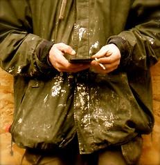Taking a break (GAV1947) Tags: mobile hands break working smoking