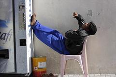 Smoking siesta- Dubai (Jon Bower) Tags: man dubai sitting break cigarette united relaxing machine smoking emirates arab vending