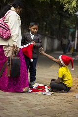 Other Side (saptarshiriju) Tags: christmas street xmas people india color children child sad expression mother streetphotography everyday kolkata inocent parkstreet