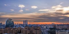 Madrid (JoseQ.) Tags: madrid atardecer edificios ciudad paisaje led cielo nubes puestadesol torres rascacielos airelibre largaexposición filtrosnd manutorrado