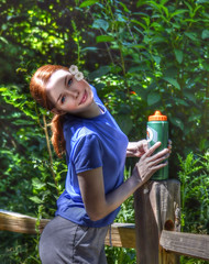 On The Fence (swong95765) Tags: flowers woman smile fence pose redhead trail hdr waterbottle