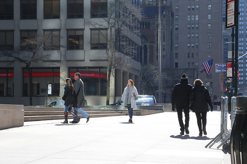 People on the Park Avenue sidewalk.