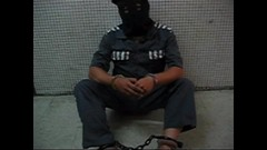 Handcuffed and shackled prisoner (asiancuffs) Tags: prison shackles handcuffs prisoner handcuffed