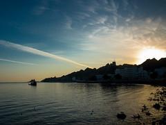 oman - la corniche (carlomao) Tags: mare nuvola alba cielo oman acqua calma muscat paesaggio allaperto