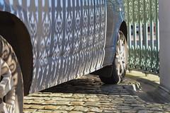 Hyde Park Corner 2feb16 (richardbw9) Tags: street city uk shadow england urban london wheel fence hilton tire grill cobblestone owl hydepark shadowplay ironwork van hubcap dazzle parklane tyre hydeparkcorner owlface mudguard wheelarch bluevan aspleyhouse