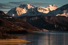 The breathtaking giants (luigig75) Tags: winter sunset italy mountain lake snow clouds montagne canon landscape lago italia central neve gran abruzzo sasso campotosto cornogrande 70d efs1022mmf3545usm parconazionaledelgransassoemontidellalaga cornopiccolo pizzointermesoli