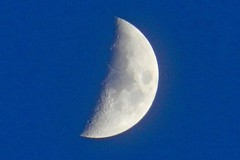 Waxing Cresent Moon (DaveJC90) Tags: camera blue winter light shadow sky moon white black cold colour detail night digital dark lens grey spring nikon warm colours bright zoom super sharp full craters crater crop round half planet coolpix phase complete cresent croped sharpness 450mm s9100