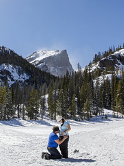 Belly Kiss at RMNP (bflinch1) Tags: trees portrait mountain snow mountains love outdoors frozen excited pregnant rockymountains rmnp kneeling excitement nationalparks rockymountainnationalpark winterwonderland newparents nymphlake bluebirdday 22weekspregnant natureportrait