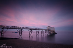Selsey Lifeboat Station at Sunset (Gavmonster) Tags: uk longexposure pink sunset sea sky beach metal clouds landscape sussex boat nikon westsussex unitedkingdom stones steel lifeboat walkway shore fishingboats boathouse selsey slipway rnli gangway lifeboathouse ndfilter lifeboatstation rnlb royalnationallifeboatinstitute 155yearsold d7000 nikond7000 gswphotography piledplatform