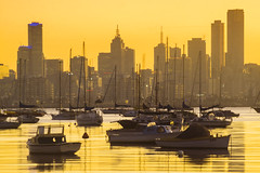 Melbourne silhouetted at sunrise (Kokkai Ng) Tags: city morning travel orange black reflection tourism silhouette horizontal skyline skyscraper marina docks sunrise dark dawn bay day cityscape harbour yacht australia melbourne williamstown luxury silhouetted clearsky crowded officeblock tranquilscene moored sailingboat groupofobjects famousplace largegroupofobjects buildingexterior hobsonsbay builtstructure nauticalvessel victoriastate williamstownaustralia