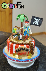 Pirate Cake (bsheridan1959) Tags: jakeandtheneverlandpiratescake piratecake kidscake birthdaycake fondant marshmallowfondant pirateflag goldcoins stripes redandwhite palmtree parrot treasurechest sand fondantrope