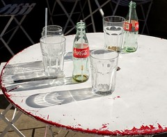 Coca Cola (pburka) Tags: nyc shadow red white glass table outside outdoors bottle empty straw coke pop drinks soda cocacola bluestonelane