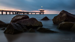guiding light (dobromir.dimitrov) Tags: longexposure blue sea sky clouds dark pier seaside rocks smooth shore