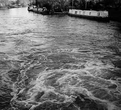 P1280051 (CamMonkeh) Tags: winter cambridge blackandwhite water contrast river boats lumix whitewater december afternoon lock sunny rapids 20mm milton weir rivercam primelens baitsbitelock microfourthirds